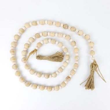 Click here to see Adams&Co 11414 11414 48x.5 wd bead grlnd w/ tassels, natural/white